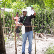 HAS Water and Sanitation Educator, Bachemir Charleron, demonstrates the construction of a tippy tap device.