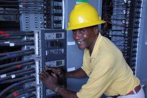 Mr.Romeo shutting off the diesel generator at the new central electric switchboard